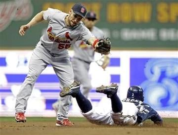 Milwaukee Brewers' Nyjer Morgan slides safely under the tag of St. Louis Cardinals' Skip Schumaker (55) as he steals second during the fourth inning of a baseball game Tuesday, Aug. 30, 2011, in Milwaukee. (AP Photo/Morry Gash) By Morry Gash