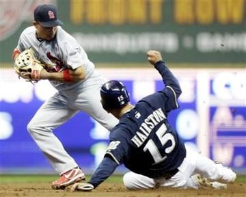 St. Louis Cardinals shortstop Rafael Furcal forces out Milwaukee Brewers' Jerry Hairston Jr. (15) to end the fifth inning of a baseball game Tuesday, Aug. 30, 2011, in Milwaukee. (AP Photo/Morry Gash) By Morry Gash