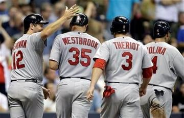 St. Louis Cardinals' Jake Westbrook (35) is congratulated after hitting a grand slam during the fourth inning of a baseball game against the Milwaukee Brewers, Wednesday, Aug. 31, 2011, in Milwaukee. (AP Photo/Morry Gash) By Morry Gash