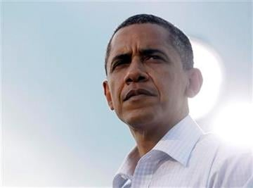 President Barack Obama pauses as he speaks during a town hall meeting, Wednesday, Aug. 17, 2011, at Country Corner Farm Market in Alpha, Ill., during his three-day economic bus tour.  (AP Photo/Carolyn Kaster) By Carolyn Kaster
