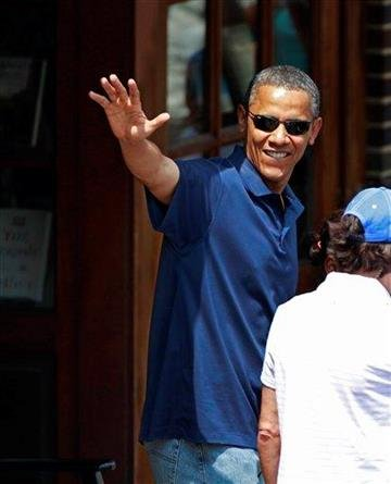 President Barack Obama, with his daughters Malia Obama and Sasha Obama, not seen, waves as they leave the Bunch of Grapes book store in Vineyard Haven, Mass., Friday, Aug. 19, 2011, during a family vacation. (AP Photo/Carolyn Kaster) By Steven Senne