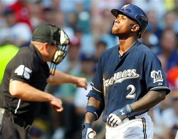 Milwaukee Brewers' Nyjer Morgan (2) reacts after striking out in the third inning of a baseball game against the St. Louis Cardinals Thursday, Sept. 1, 2011, in Milwaukee. (AP Photo/Jeffrey Phelps) By Jeffrey Phelps