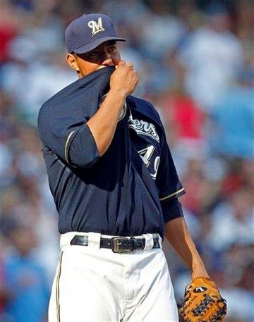 Milwaukee Brewers starting pitcher Yovani Gallardo reacts after giving up a two-run home run to St. Louis Cardinals' Matt Holliday in the fifth inning of a baseball game on Thursday, Sept. 1, 2011, in Milwaukee. (AP Photo/Jeffrey Phelps) By Jeffrey Phelps
