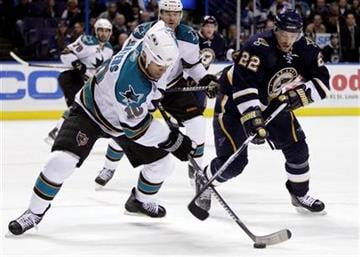 San Jose Sharks' Jamal Mayers, left, handles the puck as St. Louis Blues' Brad Boyes  (22) defends during the second period of an NHL hockey game Saturday, Dec. 18, 2010, in St. Louis. (AP Photo/Jeff Roberson) By Jeff Roberson