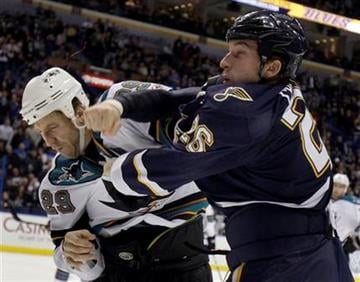 San Jose Sharks' Ryane Clowe, left, and St. Louis Blues' B.J. Crombeen fight during the first period of an NHL hockey game Saturday, Dec. 18, 2010, in St. Louis. (AP Photo/Jeff Roberson) By Jeff Roberson
