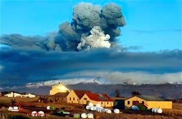 ** FOR USE AS DESIRED, YEAR END PHOTOS ** FILE - In this April 16, 2010 file photo, the volcano in southern Iceland's Eyjafjallajokull glacier sends ash into the air just prior to sunset.  (AP Photo/Brynjar Gauti, File) By Brynjar Gauti