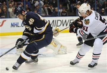 St. Louis Blues' Roman Polak (46), of Czech Republic, and Chicago Blackhawks' Brian Campbell (51) battle for a puck in the first period of an NHL  hockey game Saturday, Jan. 2,  2010, in St. Louis. (AP Photo/Bill Boyce) By Bill Boyce