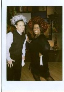 Carol Daniel and guest host Paul Cook showing off some homemade tinsel Christmas wreaths By KMOV Web Producer