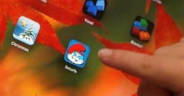 "In this photo taken Dec. 7, 2010, Sawyer Rummelhart, 4,  points to the ""The Smurf's Village"" app on his mothers iPad, at his families home in Gridley, Calif.(AP Photo/Rich Pedroncelli) By Rich Pedroncelli"