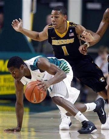 Oregon guard Johnathan Loyd dribbles as Missouri guard Phil Pressey (1) defends in the first half of an NCAA college basketball game Thursday, Dec. 2, 2010, in Eugene, Ore. (AP Photo/Rick Bowmer) By Rick Bowmer