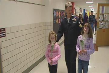U.S. Naval Petty Officer Jacob Weber surprised his daughters Alexis and Emily at Bierbaum Elementry School after spending seven months in the Persian Gulf. By KMOV Web Producer