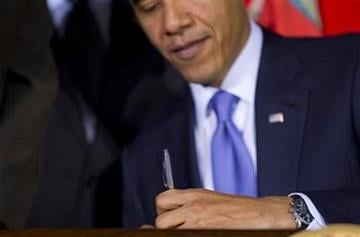 "President Barack Obama signs ""don't ask, don't tell"" repeal legislation that would allow gays to serve openly in the military, Wednesday, Dec. 22, 2010, at the Interior Department in Washington.  (AP Photo/Evan Vucci) By Evan Vucci"