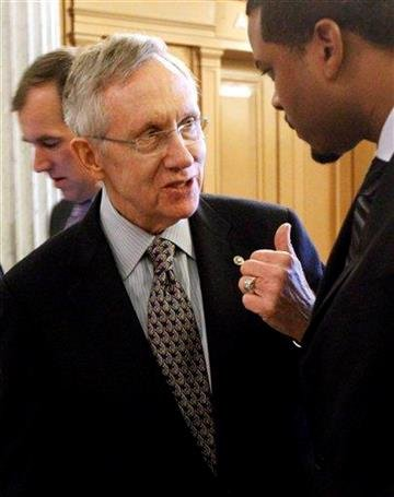 Senate Majority Leader Harry Reid of Nev. talks with aide Rodell Mollineau, right, near the Senate floor, on Capitol Hill in Washington, Wednesday, Dec. 22, 2010, as the Senate considers the New START Treaty. (AP Photo/Alex Brandon) By Alex Brandon