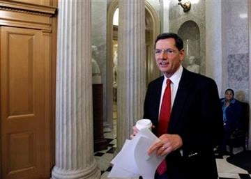 Sen. John Barrasso, R-Wyo., walks from the Senate floor, on Capitol Hill in Washington, Wednesday, Dec. 22, 2010, as they consider the New START Treaty. (AP Photo/Alex Brandon) By Alex Brandon