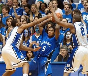 Saint Louis' Jordair Jett, center, is trapped by Duke's Josh Hairston, left, and Nolan Smith during the second half action of an NCAA college basketball game in Durham, N.C., Saturday Dec. 11, 2010.  Duke won 84-47. (AP Photo/Lynn Hey) By LYNN HEY