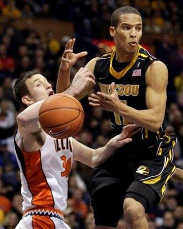 Missouri's Michael Dixon, right, is fouled by Illinois' Bill Cole on his way to the basket during the first half of an NCAA college basketball game Wednesday, Dec. 22, 2010, in St. Louis. (AP Photo/Jeff Roberson) By Jeff Roberson