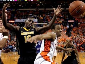 A rebound slips away from Illinois' Jereme Richmond, right, as Missouri's Ricardo Ratliffe, left, looks on during the first half of an NCAA college basketball game Wednesday, Dec. 22, 2010, in St. Louis. (AP Photo/Jeff Roberson) By Jeff Roberson