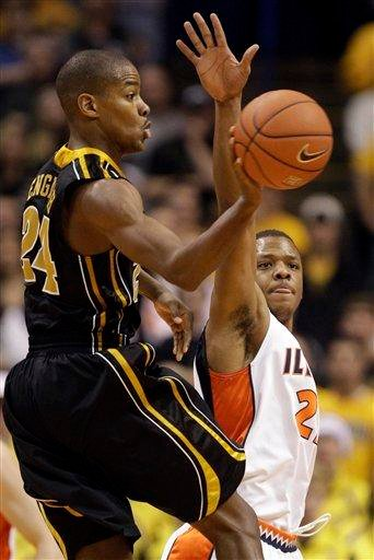 Missouri's Kim English, left, passes around Illinois' Jereme Richmond during the second half of an NCAA college basketball game Wednesday, Dec. 22, 2010, in St. Louis. Missouri won 75-64. (AP Photo/Jeff Roberson) By Jeff Roberson