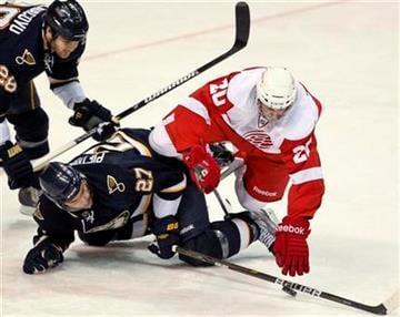 St. Louis Blues' Alex Pietrangelo (27) and Detroit Red Wings' Drew Miller collide while chasing a puck during the second period of an NHL hockey game Thursday, Dec. 23, 2010, in St. Louis. (AP Photo/Sarah Conard) By Sarah Conard