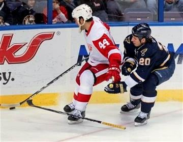Detroit Red Wings' Todd Bertuzzi steals the puck from St. Louis Blues' Alexander Steen, knocking Steen's stick out of his hand, during the first period of an NHL hockey game Thursday, Dec. 23, 2010, in St. Louis. (AP Photo/Sarah Conard) By Sarah Conard