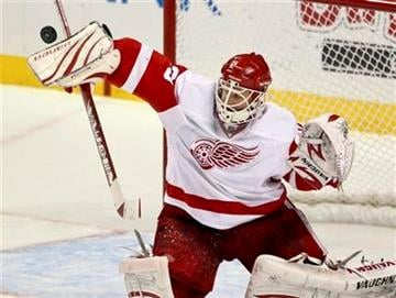 Detroit Red Wings goalie Chris Osgood blocks a shot during the second period of an NHL hockey game against the St. Louis Blues on Thursday, Dec. 23, 2010, in St. Louis. (AP Photo/Sarah Conard) By Sarah Conard