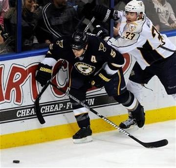 St. Louis Blues' Barret Jackman (5) battles with  Nashville Predators' Colin Wilson (33) in the second period of an NHL hockey game Sunday Dec. 26, 2010 in St. Louis. The Blues won 2-0. (AP Photo/Bill Boyce) By Bill Boyce