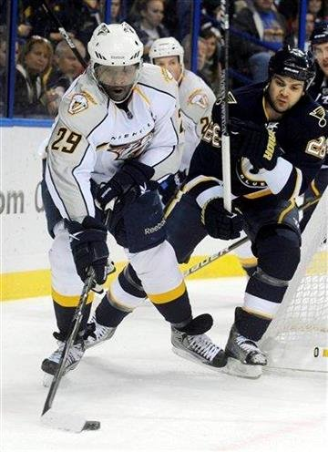Nashville Predators' Joel Ward (29) and St. Louis Blues' Carlo Colaiacovo (28) battle for the puck in the first period of an NHL hockey game Sunday Dec. 26, 2010 in St. Louis. (AP Photo/Bill Boyce) By Bill Boyce