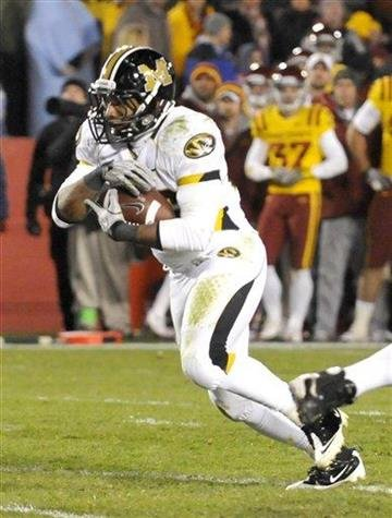 Missouri's De' Vion Moore scores a touchdown against Iowa State during second half of an NCAA college football game in Ames, Iowa., Saturday, Nov. 20, 2010. (AP Photo/Steve Pope) By Steve Pope
