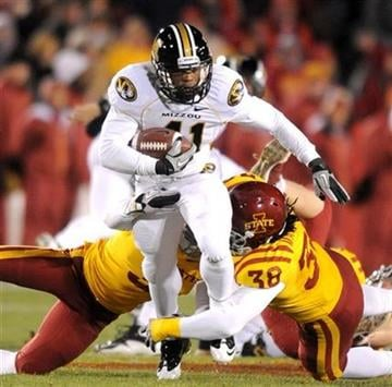 Iowa State's Zac Sandvig, bottom left, and Roosevelt Maggit, bottom right, tackle Missouri's quarterback Blaine Gabbert, top, during first half of an NCAA college football game in Ames, Iowa., Saturday, Nov. 20, 2010. (AP Photo/Steve Pope) By Steve Pope