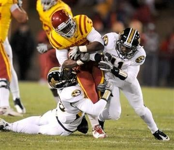 Iowa State's Alexander Robinson, center, is wrapped up by Missouri's Tavon Bolden, left, and Jarrell Harrison during first half of an NCAA college football game in Ames, Iowa., Saturday, Nov. 20, 2010. (AP Photo/Steve Pope) By Steve Pope