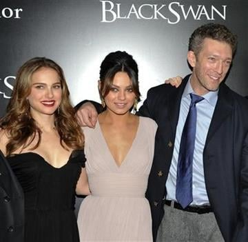 Actress Natalie Portman, left, actress Mila Kunis and actor Vincent Cassel, right, attend the premiere of 'Black Swan' at the Ziegfeld Theatre on Tuesday, Nov. 30, 2010 in New York. (AP Photo/Evan Agostini) By Evan Agostini