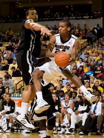 Missouri's Kim English, right, passes around Northern Illinois' Tim Toler, left, during the second half of an NCAA college basketball game Monday, Dec. 27, 2010, in Columbia, Mo. Missouri won 97-61. (AP Photo/L.G. Patterson) By L.G. Patterson