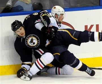 St. Louis Blues' Erik Johnson (6) collides with Chicago Blackhawks' Jack Skille, right, in the third period of an NHL hockey game Tuesday Dec. 28, 2010, in St. Louis. The Blues won 3-1.(AP Photo/Bill Boyce) By Bill Boyce