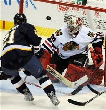 Chicago Blackhawks goalie Marty Turco (30) blocks a shot by St. Louis Blues' Patrik Berglund (21), of Sweden, in the second period of an NHL hockey game Tuesday Dec. 28, 2010 in St. Louis. (AP Photo/Bill Boyce) By Bill Boyce