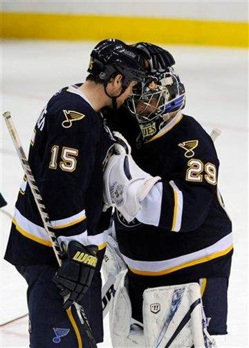 St. Louis Blues' Brad Winchester (15) congratulates goalie Ty Conklin (29) after the Blues beat the Chicago Blackhawks 3-1 in an NHL hockey game Tuesday, Dec. 28, 2010, in St. Louis. (AP Photo/Bill Boyce) By Bill Boyce