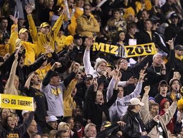 Missouri fans cheer their team during the third quarter of the Insight Bowl NCAA college football game against Iowa Tuesday, Dec. 28, 2010, in Tempe, Ariz. (AP Photo/Matt York) By Matt York
