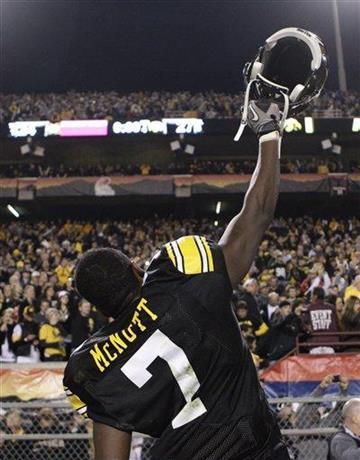 Iowa Hawkeyes wide receiver Marvin McNutt (7) acknowledges the fans after winning the Insight Bowl NCAA college football game against Missouri Tuesday, Dec. 28, 2010, in Tempe, Ariz. Iowa won 27-24. (AP Photo/Matt York) By Matt York