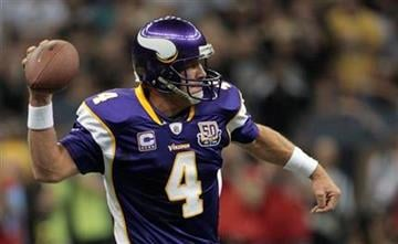 Minnesota Vikings quarterback Brett Favre looks for a receiver during the NFL football season opener against the New Orleans Saints at the Louisiana Superdome in New Orleans on Thursday, Sept. 9, 2010. (AP Photo/Dave Martin) By Dave Martin