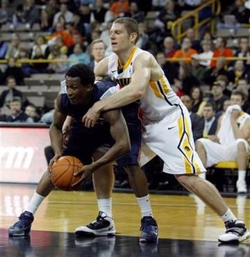 Illinois guard D.J. Richardson, left, is fouled by Iowa guard Matt Gatens during the second half of an NCAA college basketball game, Wednesday, Dec. 29, 2010, in Iowa City, Iowa. Illinois won 87-77. (AP Photo/Charlie Neibergall) By Charlie Neibergall
