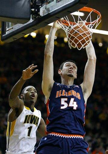 Illinois center Mike Tisdale dunks dunks in front of Iowa forward Melsahn Basabe during the first half of an NCAA college basketball game, Wednesday, Dec. 29, 2010, in Iowa City, Iowa. (AP Photo/Charlie Neibergall) By Charlie Neibergall
