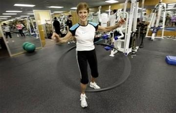 This Thursday, Dec. 16, 2010 photo shows Esther Robinson, 93, as she uses a weighted hula-hoop during a workout in Houston. Active all her life, Robinson wouldn't give up her life of fitness for anything.     (AP Photo/David Phillip) By David Phillip