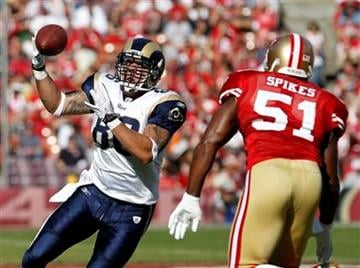 St. Louis Rams tight end Michael Hoomanawanui, left, makes a catch in front of San Francisco 49ers linebacker Takeo Spikes during the first quarter of an NFL football game in San Francisco, Sunday, Nov. 14, 2010. (AP Photo/Paul Sakuma) By Paul Sakuma