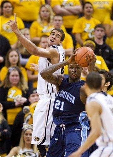 Old Dominion's Frank Hassell (21), right, pulls a rebound away from Missouri's Justin Safford, top, during the first half of an NCAA college basketball game Thursday, Dec. 30, 2010, in Columbia, Mo. (AP Photo/L.G. Patterson) By L.G. Patterson