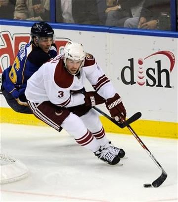 Phoenix Coyotes' Keith Yandle (3) gets around St. Louis Blues' Matt D'Agostini, left, in the second period of an NHL hockey game Friday, Dec. 31, 2010, in St. Louis. (AP Photo/Bill Boyce) By Bill Boyce