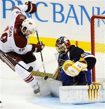 St. Louis Blues goalie Jaroslav Halak (41), of Slovakia, blocks a shot by Phoenix Coyotes' Shane Doan (19) in the third period of an NHL hockey game Friday, Dec. 31, 2010, in St. Louis. St. Louis won 4-3. (AP Photo/Bill Boyce) By Bill Boyce