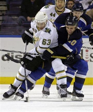 Dallas Stars' Mike Ribeiro (63) battles St. Louis Blues' Alexander Steen (20) for the loose puck in the first period of an NHL hockey game, Sunday, Jan. 2, 2011, in St. Louis. (AP Photo/Tom Gannam) By Tom Gannam