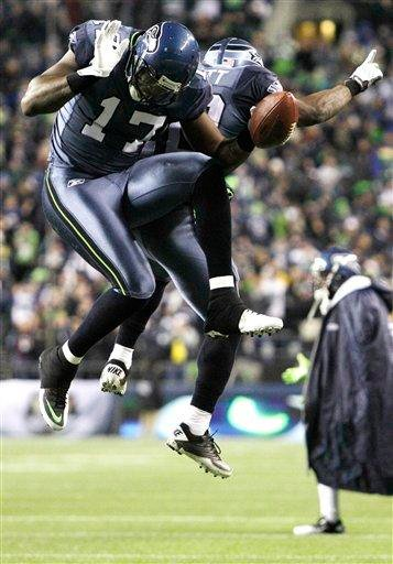 Seattle Seahawks' Mike Williams celebrates with teammate Justin Forsett after Williams scored a touchdown against the St. Louis Rams in the first half of an NFL football game, Sunday, Jan. 2, 2011, in Seattle. (AP Photo/Elaine Thompson) By Elaine Thompson