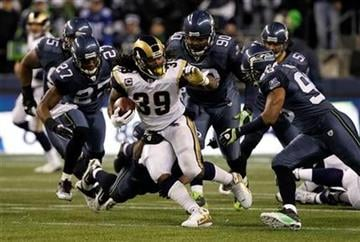 St. Louis Rams' Steven Jackson (39) runs in the first half of an NFL football game against the Seattle Seahawks, Sunday, Jan. 2, 2011, in Seattle. (AP Photo/Elaine Thompson) By Elaine Thompson