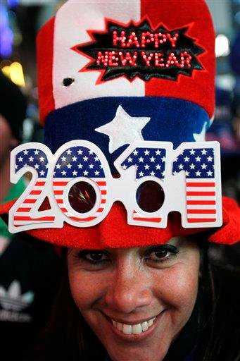 Monica Neira from Argentina waits for the new year in Times Square in New York, Friday, Dec. 31, 2010. (AP Photo/Seth Wenig) By Seth Wenig