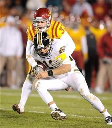 Iowa State's Michael O'Connell, top, wraps up Missouri's quarterback Blaine Gabbert during second half of an NCAA college football game in Ames, Iowa., Saturday, Nov. 20, 2010. (AP Photo/Steve Pope) By Steve Pope